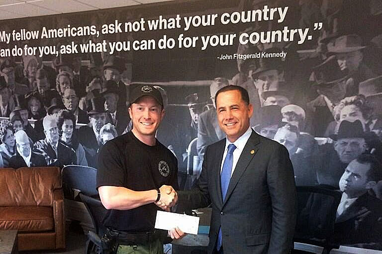 Mayor Philip Levine presents donation for Beach Police Officer